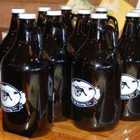 A collection of Battle Hill growlers